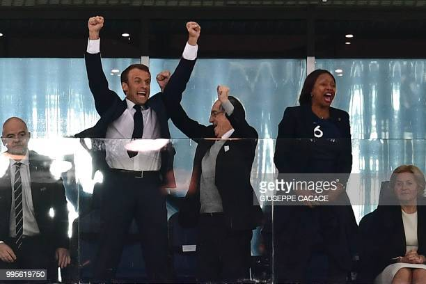 TOPSHOT French President Emmanuel Macron celebrates alongside French Football Federation president Noel Le Graet and French Sports Minister Laura...