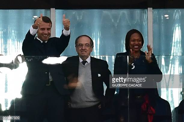 French President Emmanuel Macron celebrates the team's goal alongside French Football Federation president Noel Le Graet and French Sports Minister...