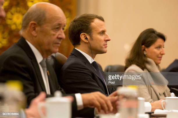 French President Emmanuel Macron center listens during a meeting with Chinese Premier Li Keqiang not shown at the Great Hall of the People on January...