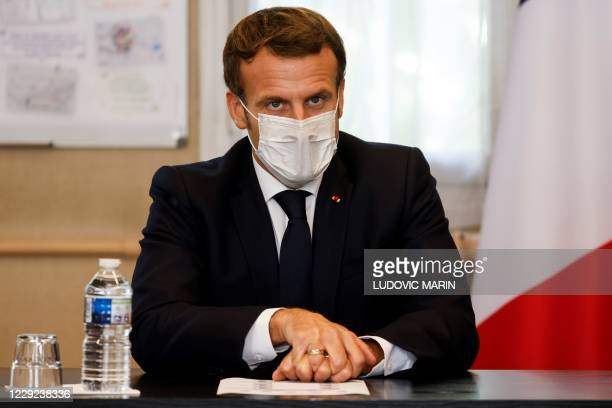 French President Emmanuel Macron chairs a meeting with the medical staff of the Rene Dubos hospital center in Pontoise in the Val d'Oise on October...