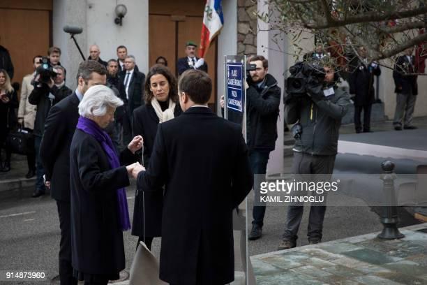 French President Emmanuel Macron Claude Erignac's widow Dominique Erignac son CharlesAntoine and daughter MarieChristophine take part in the...