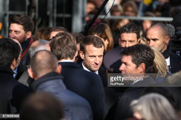French President Emmanuel Macron comforts relatives of victim near the Bataclan concert venue during a ceremony marking the second anniversary of the...