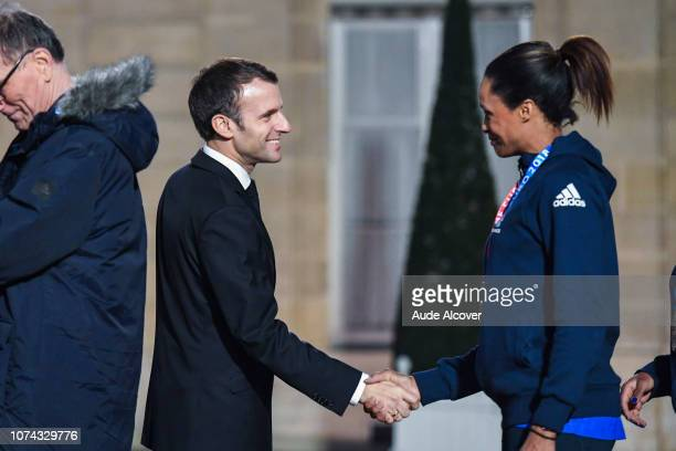 French president Emmanuel Macron congratulates Allison Pineau during the Reception at the Elysee in honor of the French Women's Handball team...