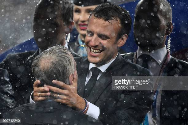 TOPSHOT French President Emmanuel Macron congratulates France's coach Didier Deschamps during the trophy ceremony at the end of the Russia 2018 World...