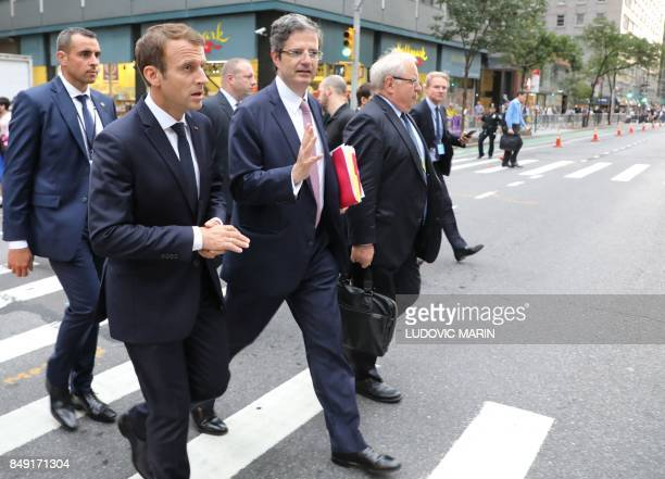 French President Emmanuel Macron crosses the road with Francois Delattre France's Permanent Representative to the UN as they walk down 2nd Avenue to...