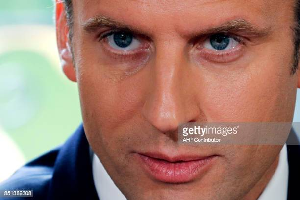 French President Emmanuel Macron delivers a speech after signing documents s in front of the media to promulgate a new labour bill in his office at...