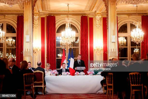 French President Emmanuel Macron delivers a speech as his wife Brigitte Macron Grand Duke of Luxembourg Henri and his wife Maria Teresa Grand Duchess...