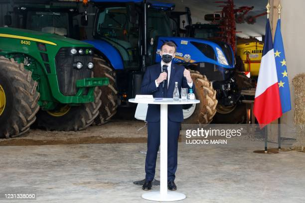"""French President Emmanuel Macron delivers a speech at """"La Ferme d'Etaules"""" farm during an official one-day trip in Burgundy focused on Agricultural..."""