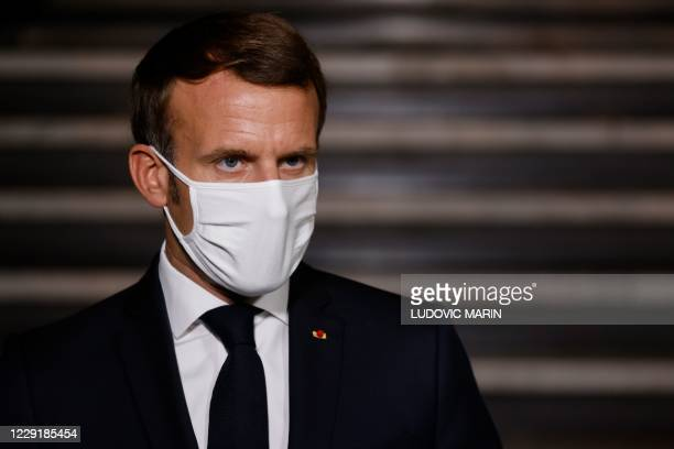 French President Emmanuel Macron delivers a speech at the end of a visit on the fight against separatism at the Seine Saint Denis prefecture...
