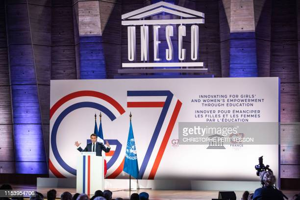 French President Emmanuel Macron delivers a speech at the UNESCO headquarters in Paris on July 5 during the G7 Development and Education Ministers...