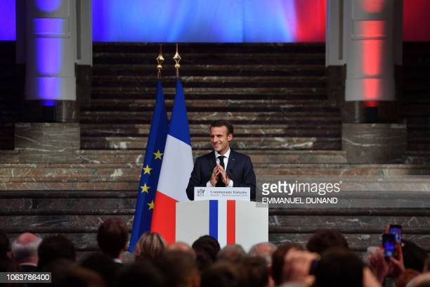 French President Emmanuel Macron delivers a speech during a Frenchspeaking community reception at the BOZAR Centre for Fine Arts in Brussels on...