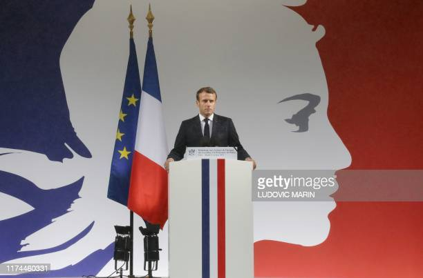 French President Emmanuel Macron delivers a speech during a ceremony at The Prefecture de Police de Paris in Paris on October 8 held to pay respects...