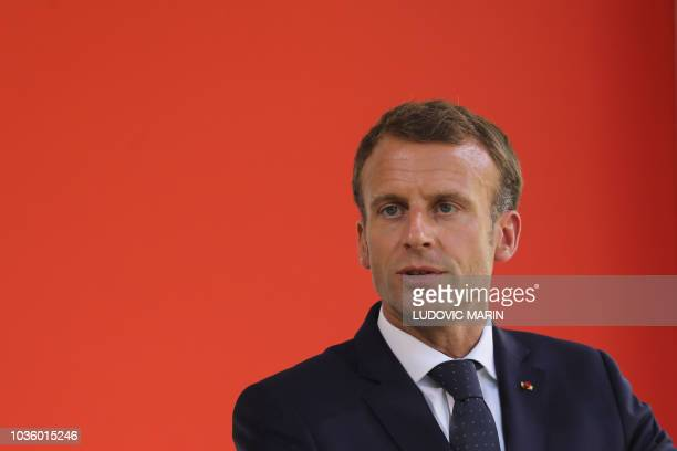 French President Emmanuel Macron delivers a speech during a national ceremony to pay tribute to the victims of terrorism, in Paris, on September 19,...
