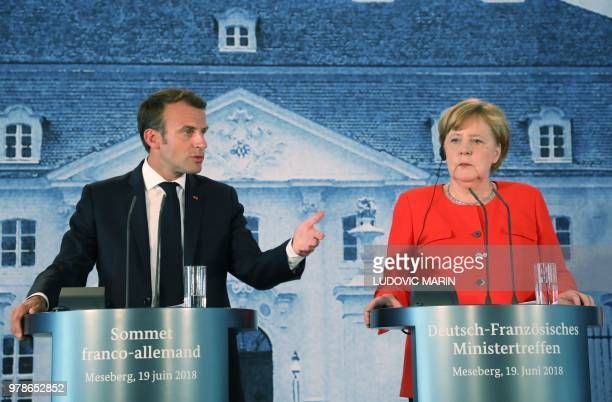 French President Emmanuel Macron delivers a speech during a press conference after bilateral talks with German Chancellor Angela Merkel on June 19 at...