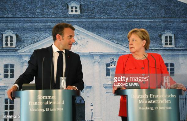 French President Emmanuel Macron delivers a speech during a press conference after bilateral talks with German Chancellor on June 19 at the Meseberg...