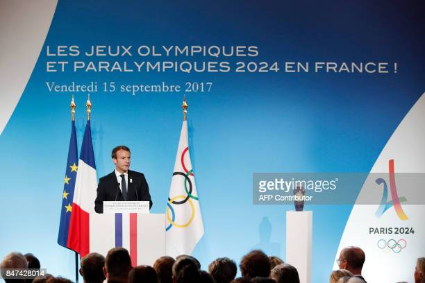 French President Emmanuel Macron delivers a speech during a welcoming ceremony to celebrate Paris' coronation as host of the 2024 Olympics Games at...