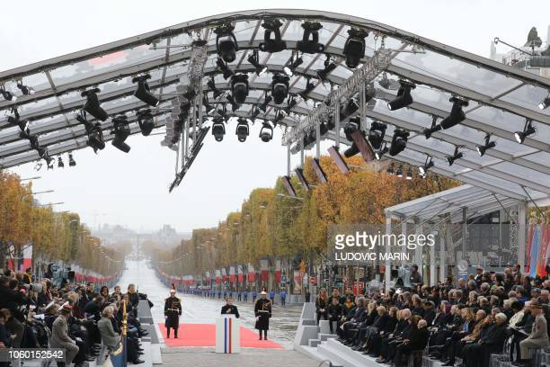 French President Emmanuel Macron delivers a speech during in a ceremony at the Arc de Triomphe in Paris on November 11, 2018 as part of...