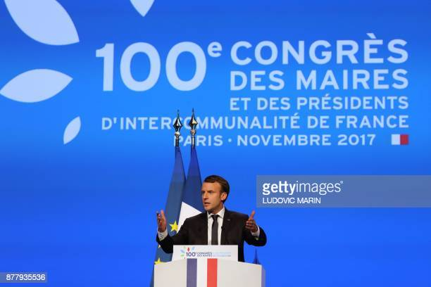 French President Emmanuel Macron delivers a speech during the 100th French Mayors congress on November 23 2017 at the Porte de Versailles exhibition...