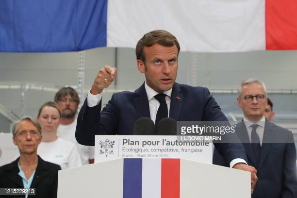 TOPSHOT French President Emmanuel Macron delivers a speech flanked by French Economy and Finance Minister Bruno Le Maire and French Minister for the...