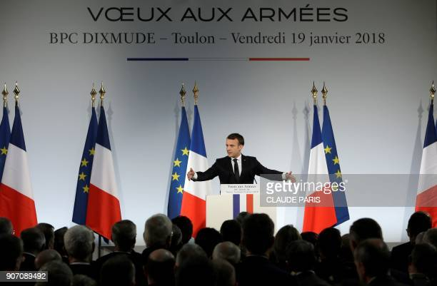 French President Emmanuel Macron delivers a speech to present his New Year's wishes to the armed forces aboard the French Mistral Class assault ship...