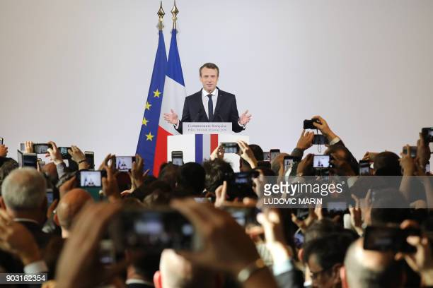 TOPSHOT French President Emmanuel Macron delivers a speech to the French community at the country's embassy in Beijing on January 10 2018 Macron is...