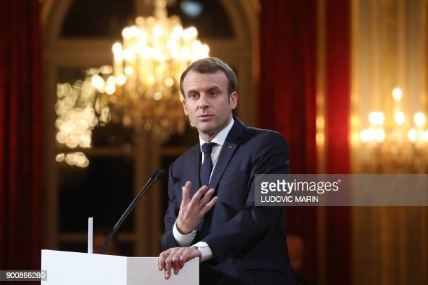 French President Emmanuel Macron delivers his New Year wishes to the press at the Elysee Palace in Paris, on January 3, 2018.