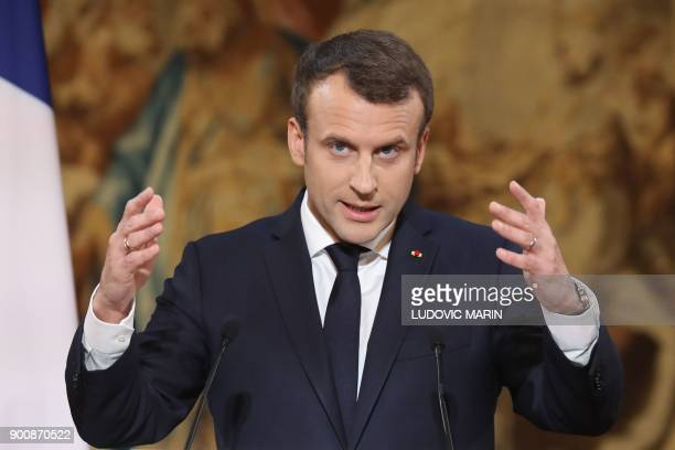 French President Emmanuel Macron delivers his New Year wishes to the press at the Elysee Palace in Paris on January 3 2018 / AFP PHOTO / POOL /...