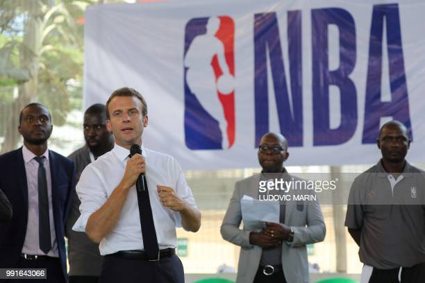 French President Emmanuel Macron delivers his speech during a meeting with former pro basketball players from NBA Africa and a training with young...