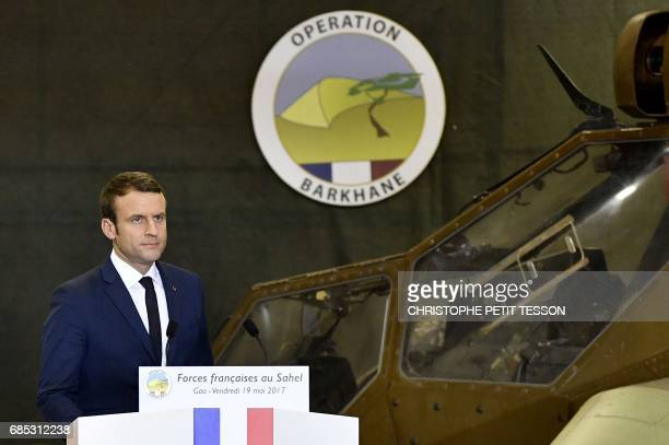 French President Emmanuel Macron delivers his speech during his visit to the troops of France's Barkhane counter-terrorism operation in Africa's...