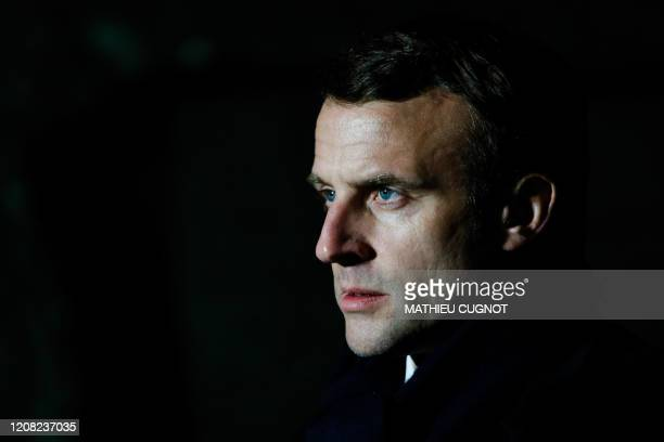 TOPSHOT French President Emmanuel Macron delivers speech after the visit of the military field hospital outside the Emile Muller Hospital in Mulhouse...