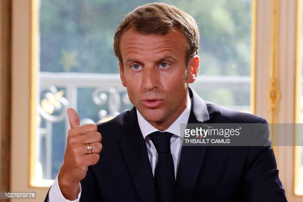 French President Emmanuel Macron delviers a speech during an event to sign documents enacting a new labour law named Labour freedom of choice of...
