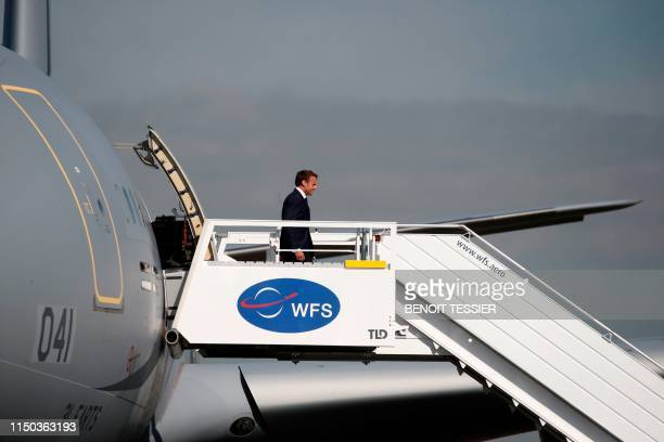 French President Emmanuel Macron disembarks from an Airbus A330 MRTT as he arrives at the 53rd International Paris Air Show at Le Bourget Airport...
