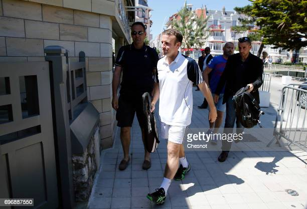 French President Emmanuel Macron dressed in tennis player returns to his house on the eve of the second round of the French parliamentary elections...