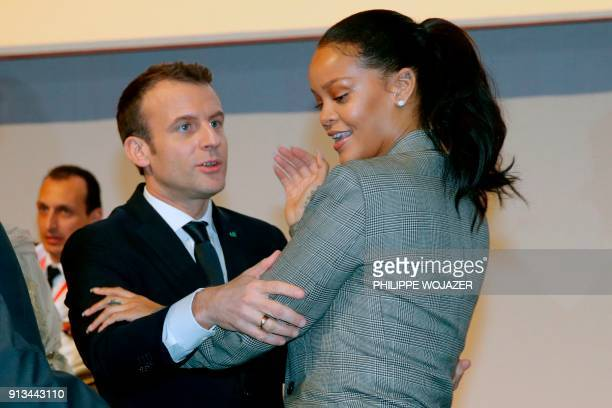 French President Emmanuel Macron embraces Barbadian singer Rihanna as they attend the conference 'GPE Financing Conference an Investment in the...