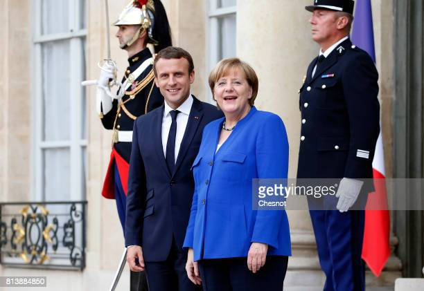 French President Emmanuel Macron escorts German Chancellor Angela Merkel after their meeting at the Elysee Presidential Palace on July 13 2017 in...