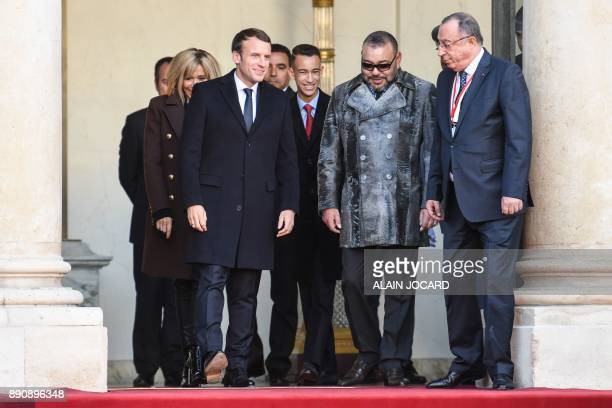 French President Emmanuel Macron escorts King Mohammed VI of Morocco and Crown Prince of Morocco Moulay Hassan as they leave the Elysee palace on...