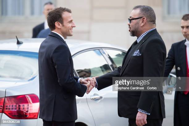 French President Emmanuel Macron escorts King Mohammed VI of Morocco as he leaves the Elysee Presidential Palace on April 10 2018 in Paris France...