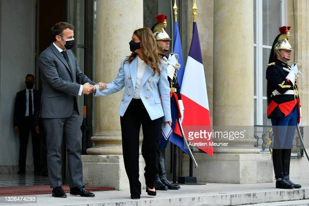 French President Emmanuel Macron escorts Melinda Gates after a meeting for the Generation Equality Forum at Elysee Palace on July 01, 2021 in Paris,...