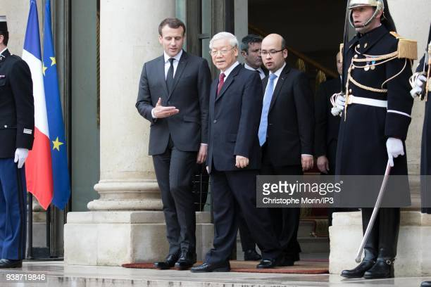 French President Emmanuel Macron escorts Vietnamese Communist Party chief Nguyen Phu Trong after a meeting at Elysee Palace on March 27 2018 in Paris...