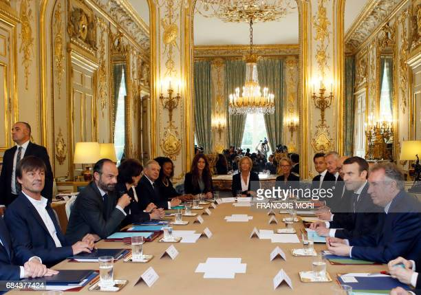 French President Emmanuel Macron faces his Prime Minister Edouard Philippe during the first weekly cabinet meeting of the new government at the...