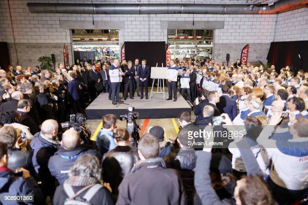 French President Emmanuel Macron flanked by Didier Leroy TMC vicepresident and factory's Director Luciano Biondo visits Toyota's automobile...