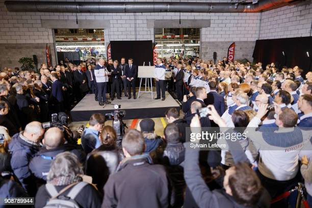 French President Emmanuel Macron flanked by Didier Leroy Toyota Motor Corporation vicepresident and factory's Director Luciano Biondo visits Toyota's...