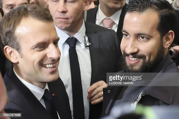 TOPSHOT French president Emmanuel Macron flanked by Elysee senior security officer Alexandre Benalla visits the 55th International Agriculture Fair...