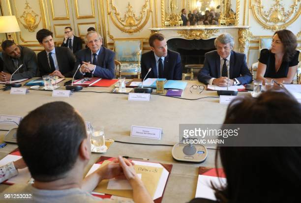 French president Emmanuel Macron flanked by French entrepreneur Allaoui Guenni French Minister of State for the Territorial Cohesion Julien...