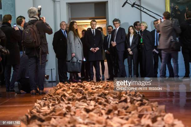 French President Emmanuel Macron flanked by French Junior Minister for Gender Equality Marlene Schiappa and Fesch Museum director Philippe Costamagna...