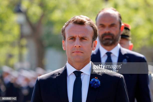 French President Emmanuel Macron, flanked by French Prime Minister Edouard Philippe , attends the ceremony marking the 73rd anniversary of the...