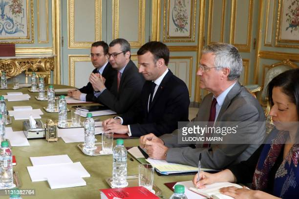 French president Emmanuel Macron flanked by his cabinet director Patrick Strzoda and Elysee general secretary Alexis Kohler holds a meeting on March...