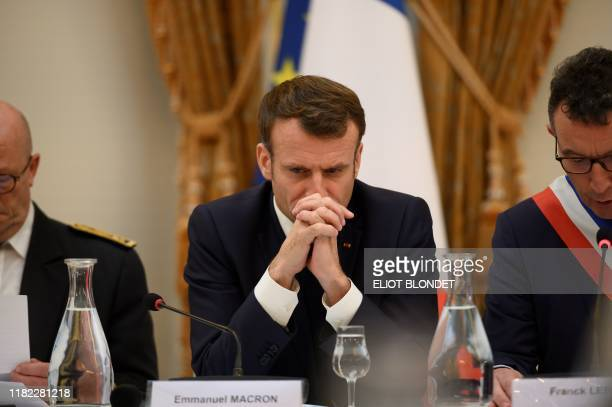 French President Emmanuel Macron flanked by mayor of Epernay Franck Leroy takes part in the Municipal Council at Epernay's cityhall on November 14...