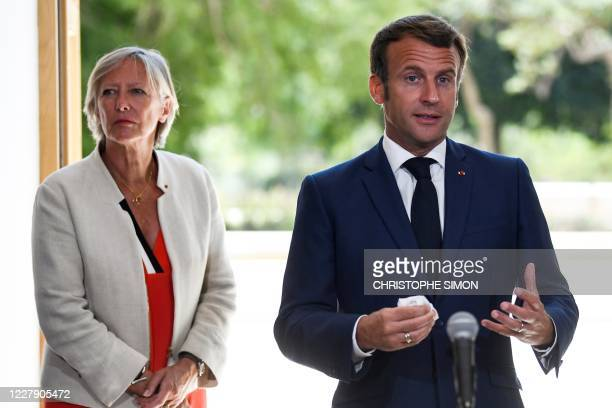 French President Emmanuel Macron , flanked by Secretary of State to the Prime Minister, in charge of People with disabilities Sophie Cluzel ,...