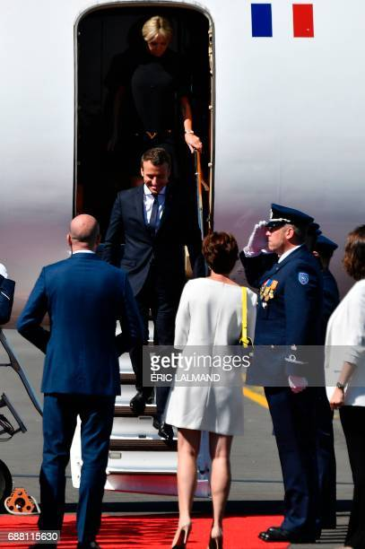 French President Emmanuel Macron followed by his wife Brigitte Macron is welcomed by Belgian Prime Minister Charles Michel and his partner Amelie...
